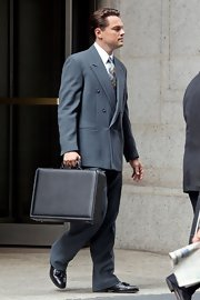Leonardo DiCaprio fit right in on Wall Street with this black leather briefcase.