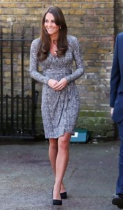 Kate Middleton showed off her baby bump in this textured print wrap-dress with long sleeves.