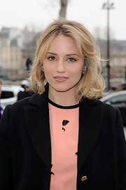 Dianna Agron attended the Louis Vuitton fall 2012 runway show wearing her hair in big loose waves with side-swept bangs.