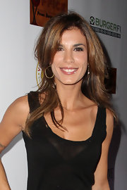 Elisabetta Canalis let her hair down at the opening of Vic and Angelo's. She looked casual and relaxed with her her long, layered locks minimally styled.