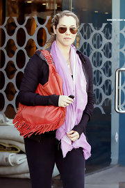 Elizabeth Berkley kept her workout style funky with a red fringed hobo.