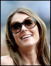Elizabeth Hurley knows how to complement her features with a chocolate brown pair of round sunglasses.