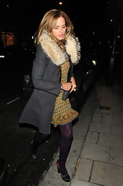 Trinny Woodall kept warm in chic style with a fur-collared wool coat.
