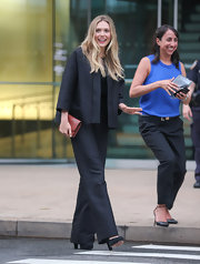 Elizabeth Olsen showed off her long and lean figure with a relaxed-fit black suit.