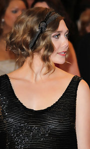 Elizabeth Olsen pinned her loose curls up in a elegant updo and topped it off with a beaded headband.