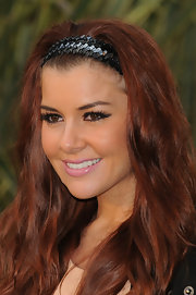 Imogen adds a touch of sparkle to her red carpet look with a sequined headband.