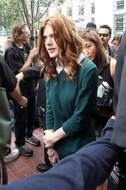 Rose Leslie's long curls popped against her green collared shirt.