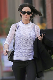 Emily Blunt wore this sporty mesh knit top while out and about in NYC.