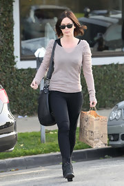 Emily Blunt ran errands in a sheer taupe sweater with ruched sleeves.