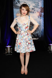 An Australian native, Emily Browning felt right at home on the red carpet in Sydney for the Sucker Punch premiere. The petite actress plunged into spring wearing a floral and lace frock by Erdem. She opted not to accessorize and wore nude platform pumps for added height.