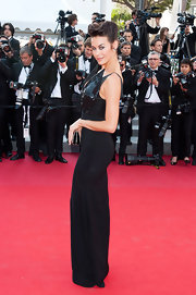 Megan Gale looked bold on the Cannes red carpet in a black evening dress with pointy accents on the bodice.