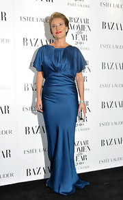 Emma looks exquisite in a brilliant blue floor length gown with butterfly sleeves.