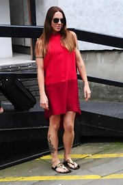 Mel C went for a comfy yet stylish look with a fishtail dress in two shades of red during a visit to the ITV Studios.
