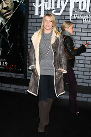 Melissa wore a thick  leather coat with knee high boots to the 'Harry Potter' premiere.
