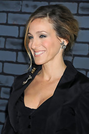 Sarah Jessica Parker paired her Vivienne Westwood dress with cluster diamond stud earrings while attending the premiere of 'Harry Potter and the Deathly Hallows'. Her stunnign earrings were the perfect complement to her elegant updo.