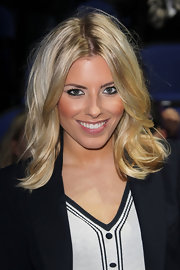 Mollie King wore her blond waves in a tousled, shoulder-length style at the Tennis Masters in London.