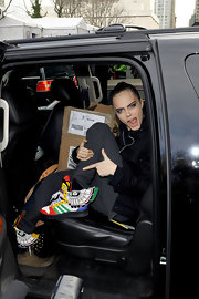 Cara Delevingne's basketball shoes had a fun twist with bright colors and wings on the sides.