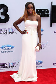 Estelle stunned in a crisp white strapless gown, which she wore to the 2013 BET Awards.