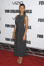 Thandie Newton paired minimal strappy sandals by Calvin Klein to a pared-down gray dress by the designer.