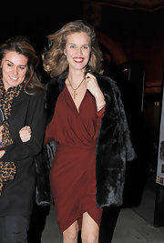 Eva Herzigova kept her look sophisticated by throwing a fur coat over her aubergine dress.