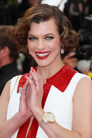 Supermodel Milla Jovovich was a retro beauty at the Cannes premiere of 'The Conquest.' She styled her hair in side swept soft curls.