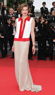 Milla was deliciously fashionable in a sequin saturated shirt dress inspired evening gown.