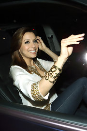 Eva waved to her fans and the endless paparazzi while leaving her restaurant Beso with husband Tony Parker.