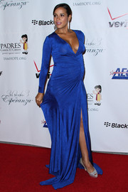 Dania Ramirez made pregnancy look so sexy in a cobalt evening dress with a revealing neckline and a thigh-high slit during the Padres Contra El Cancer event.