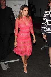 Eva Longoria was equal parts naughty and nice in this see-through pink cocktail dress by Elie Saab during her charity dinner.