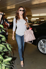 Eva Longoria left the salon in a paper thin gray t-shirt and skinny jeans.