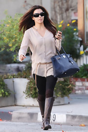Eva Longoria was relaxed and lovely in a sheer blush tunic and tight black leggings.