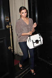 Eva Longoria was spotted exiting her restaurant carrying a luxe white leather Resort 2011 tote with black and gold accents.