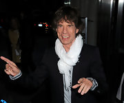 A white scarf gave Mick Jagger's black evening jacket a clean and crisp lift.
