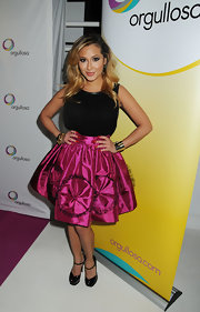 Adrienne Bailon chose a hot pink and black cocktail dress for her look at the 'Skirts Only' fashion show.