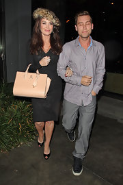 Lisa Vanderpump toted a nude leather bag while on a stroll with Lance Bass in Los Angeles.
