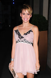 Kimberly, who's known for her chic short styles, sported a piecey, side-parted razor cut with a feminine pink cocktail dress.