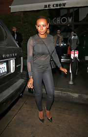 Melanie Brown showed off her fit figure with skinny pants and a fitted blouse.