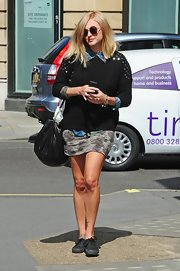 Balancing everything going on up top, Fearne finished her look with itty-bitty mini.