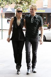 Delta Goodrem was a looker on the streets of Sydney in a low-cut sleeveless black blouse with an embellished neckline.