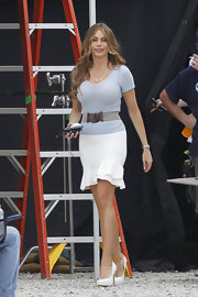 Sofia Vergara showed off her killer curves with this belted pale blue V-neck sweater.