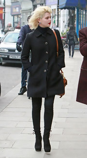 Pixie Geldof looked ladylike in a honeycomb coat with antique-style buttons.