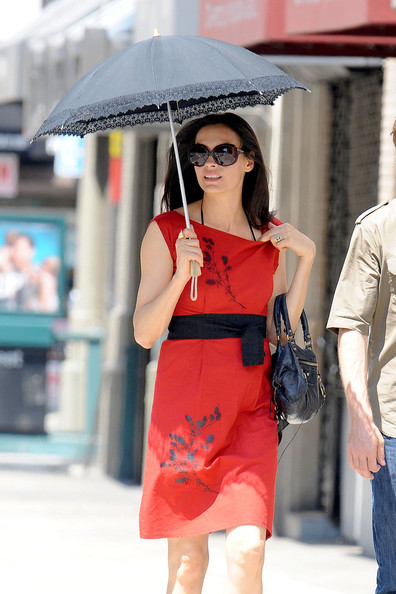 Famke Janssen protected herself from the hot NYC weather with a lace trim umbrella.