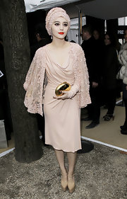 Fan Bingbing carried a glamorous gold metallic hard case clutch at the Elie Saab show.