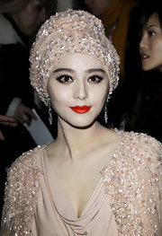 Fan is decadently glamorous in a bead saturated cream turban at the Elie Saab fashion show in Paris.