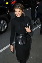 Nina Garcia completed her all-black Fashion Week ensemble with a knit scarf.