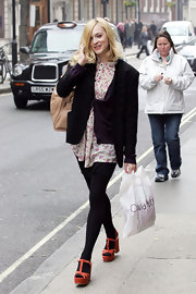 Fearne Cotton wore orange T-strap wedges over a pair of black opaque tights.