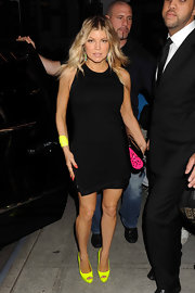 Fergie added serious kick to her LBD with neon yellow Yves peep-toes.