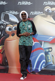 Snoop Dogg wore a printed baseball tee to the 'Turbo' premiere in Madrid.