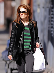 Julianne Moore contrasted a faded green striped T-shirt under her leather jacket.