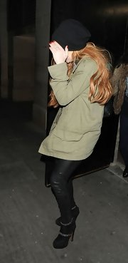 Lindsay Lohan stepped out in a pair of suede, knee-high boots.